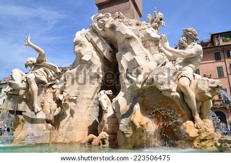 ROME, ITALY - AUGUST 21, 2014: Beautiful Fountain of the Four Rivers on Piazza Navona in Rome, Italy. The fountain was sculpted by Gian Lorenzo Bernini in 1651. - stock photo