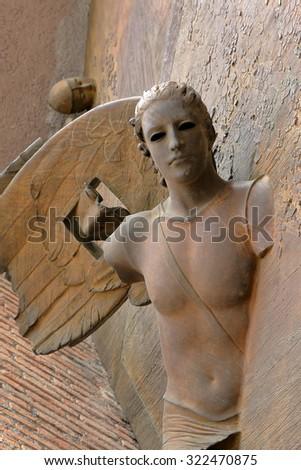 Rome, Italy - August 17, 2015: Detail of angel from gate of basilica Santa Maria degli Angeli e dei Martiri by sculptor Igor Mitoraj  - stock photo