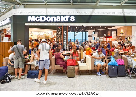 ROME, ITALY - AUGUST 04, 2015: McDonald's in Fiumicino Airport. The McDonald's Corporation is the world's largest chain of hamburger fast food restaurants - stock photo