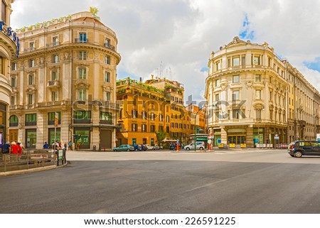 Rome, Italy - August 31, 2014: Morning traffic in the center of Rome.  Buildings in Rome on August 31, 2014.