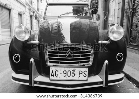 Rome, Italy - August 9, 2015: Old-timer Citroen 2cv6 Special car stands parked on the city roadside, closeup front view with wide angle lens effect - stock photo