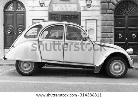 Rome, Italy - August 9, 2015: Old-timer Citroen 2cv6 Special car stands parked on the city roadside, side view - stock photo