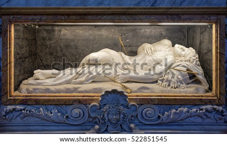 Rome, Italy - August 18, 2016: Tomb of St. Sebastian with a statue by Giorgetti and Bernini in Basilica of St. Sebastian Outside the Walls in Rome, Italy