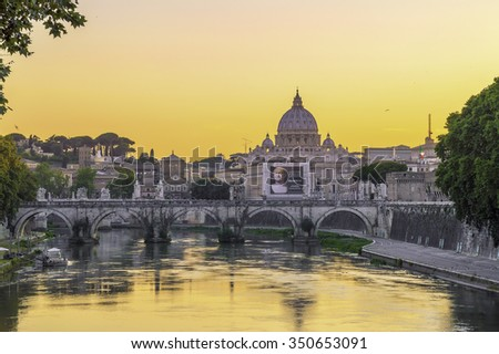 Rome, Italy - circa June 2015 - View of Rome at sunset, with Vatican and St Peter's basilica in the background, and bridge over the Tiber