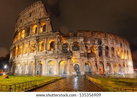 ROME, ITALY - DEC 10: Ancient Roman Colosseum at night, The largest amphitheatre in the world, is an elliptical amphitheatre in the centre of Rome, Italy on Dec 10, 2012. - stock photo