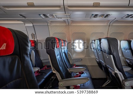 ROME, ITALY - DECEMBER 2, 2016: Alitalia aircraft close-up with seat and windows