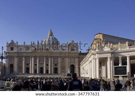 ROME, ITALY - DECEMBER 31 2014: Saint Peters Basilica and its colonnade in Piazza San Pietro In Rome, with people around the square