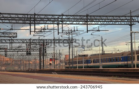ROME, ITALY - DECEMBER 6, 2014: train in Tiburtina Railway station at early morning - stock photo