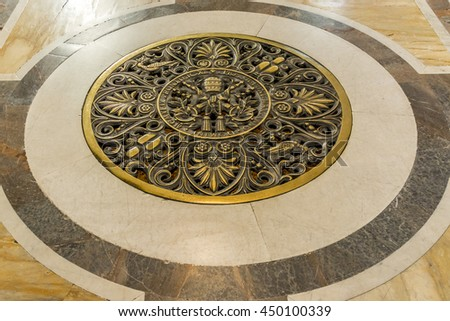 ROME, ITALY, E.U - SEPTEMBER 25, 2015: Vatican City. papal seal on the floor inside of St. Peter's Basilica