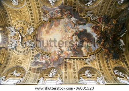 Rome, Italy. Famous painting in the ceiling of Gesu Church (Chiesa del Gesu) - Triumph of the Name of Jesus, by Giovanni Battista Gaulli - stock photo