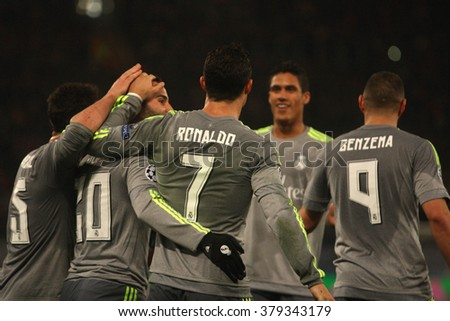 ROME, ITALY-FEBRUARY 2016 : Jese celebrates with his teammates  in  fotball match  of Uefa Champions League last-16 between A.s. Roma vs Real Madrid at the Olimpic Stadium on Februry 17, 2016 in Rome - stock photo