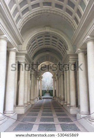 ROME, ITALY - FEBRUARY 1, 2015: Palazzo Spada the forced perspective gallery by Francesco Borromini. The baroque corridor is only nine meters long, but looks much longer