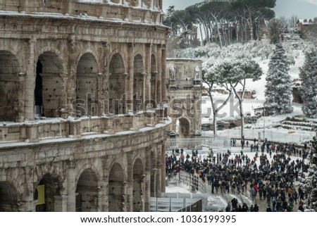 Rome, Italy, february 26th 2018: A magic day of snow in Rome at Colosseum, the Arch of  Constantine in background