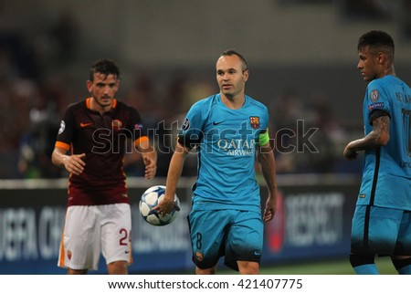 "ROME, ITALY - FEBRURY 2016 : iniesta Florenzi in action during football match  of Italian League ""Serie A"" between A.s. Roma  vs Barcellona at the Olimpic Stadium  on Februry 7, 2016 in Rome."
