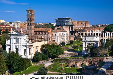 Rome, Italy. Image with ruins of ancient Roman Forum and Coliseum (Colosseum), from Roman Empire civilization. - stock photo