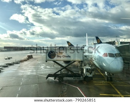 Rome, Italy - January 2, 2018: An airplane is supplied during a stopover at Fiumicino airport in Rome