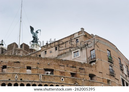 ROME, ITALY - JANUARY 27, 2010: Bronze statue of Michael the Archangel on the top of Castel Sant'Angelo in Rome, Italy. - stock photo