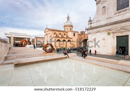 Rome, Italy - January 25, 2015: Exterior view of the Ara Pacis Augustae and the church of San Rocco in the historic centre of Rome.