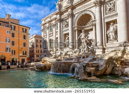 ROME, ITALY - JANUARY 15, 2013: Fontana di Trevi - largest Baroque fountain in Rome and one of most famous in the world, designed by architect Nicola Salvi. It is 26.3 meters high, 9.15 meters wide. - stock photo