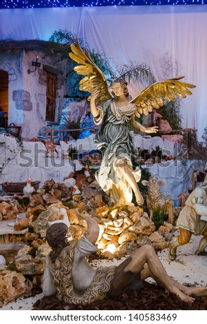ROME, ITALY-JANUARY 10:Nativity Scene in St Peter's Square, which was given this year by the Region of Basilicata and set in landscapes in mainstream Sassi of Matera on January 10,2013 in Rome-Italy - stock photo
