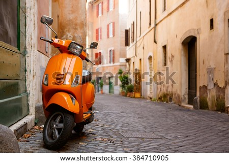 ROME ITALY - JANUARY 7: Old colorful city with bike on January 7, 2016 in Rome, Italy.Old city street with motorbike in Rome, Italy. On sunny autumn or spring day. - stock photo