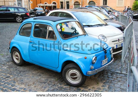 ROME, ITALY - JULY 31, 2014: Cyan tiny retro car Fiat 500 at the city street. - stock photo