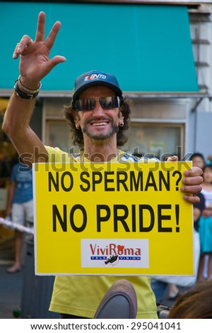 ROME, ITALY - JULY 9, 2005: People attend the Gay pride day in the city streets on July 9, 2005 in Rome, Italy.
