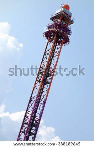 Rome, Italy - July 2013; People having funshooted upward or downward at full speed on a tower attraction in Rainbow Magicland funfair in Rome, Italy - stock photo