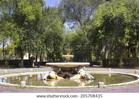 Rome, Italy - July 02: picturesque landscape with fountain at Villa Borghese gardens, on July 02, 2014, Rome, Italy