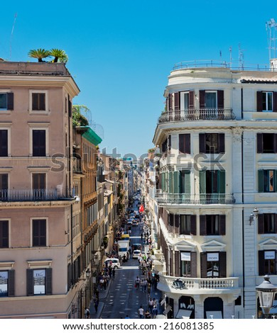 ROME, ITALY  JULY 15: Via Condotti, Rome. This street is the center of fashion shopping in Rome with the atelier of Bulgari, Armani, Cartier, Fendi, Gucci, Prada and others.  - stock photo
