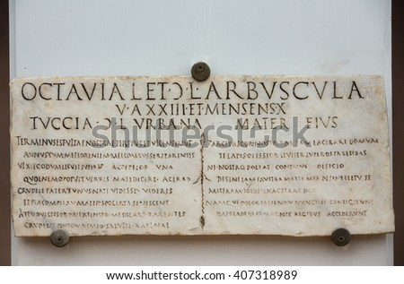 ROME, ITALY - JUNE 12, 2015: A funerary slab of Priscus in the baths of Diocletian in Rome. Italy