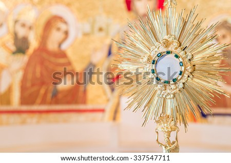 Rome, Italy - June 2015 - Adoration monstrance with the Blessed Sacrament on the altar with copy space for text - stock photo