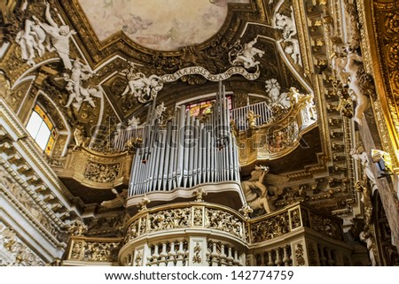ROME, ITALY - JUNE 4: Cantoria of the Santa Maria della Vittoria church in Rome, Italy at June 4, 2012. Church was opened at 1620 and cantoria was decorated by Mattia de Rossi. - stock photo