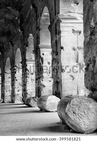 ROME, ITALY - JUNE 12, 2012: Colonnade of Colosseum the most well-known and remarkable landmark of Rome and Italy - stock photo
