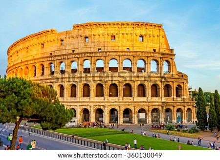 ROME, ITALY - JUNE 19: Many tourists visiting The Colosseum or Coliseum, also known as the Flavian Amphitheatre in Rome in the evening before sunset, Italy on June 19, 2015. - stock photo