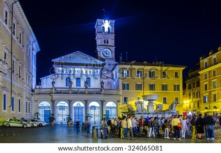 ROME, ITALY, JUNE 1, 2014: night view of piazza di santa maria situated in front of the basilica with the same name in trastevere district in rome. - stock photo