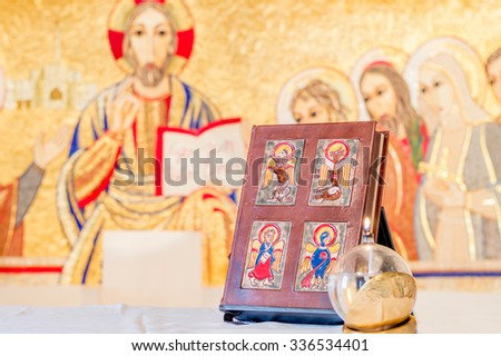 Rome, Italy - June 2015 - The Book of Gospels, Holy Bible or Holy Scripture on the altar, illustrative editorial - stock photo