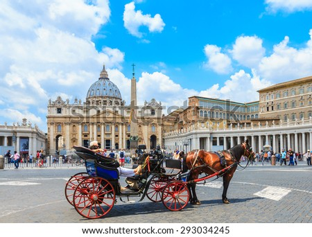 ROME, ITALY- JUNE 20: Tourists on the horse carriage at the Papal Basilica of St. Peter in the Vatican on June 20, 2015. St. Peter's Basilica is a Late Renaissance church located at Vatican City. - stock photo