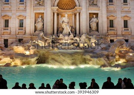 ROME, ITALY - MARCH 14, 2016: Crowd of tourists visiting and posing in the front of the Trevi fountain (Fontana di Trevi), one of the major sights of Rome - stock photo