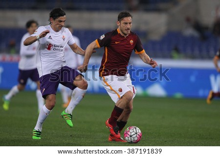 ROME, ITALY - march  2016 : Fernandez and Totti  in action during fotball match  serie A  League 2015/2016 between A.s. Roma  vs Fiorentina  at the Olimpic Stadium  on march 4, 2016 in Rome.
