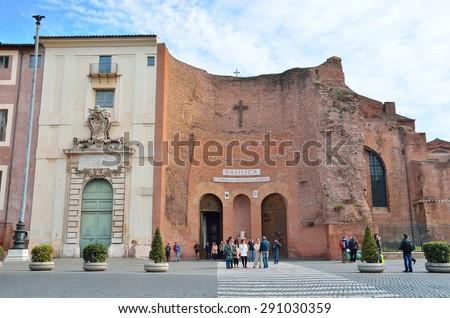 Rome, Italy, March, 17, 2013, People walking near Basilica of Santa Maria degli Angeli e dei Martiri in Rome - stock photo