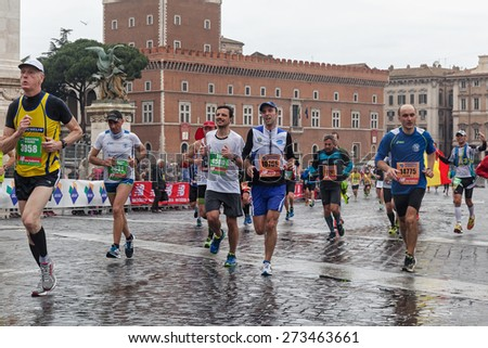 Rome, Italy - March 22, 2015: Some participants in the twenty-first Rome Marathon run through the last meters to the finish line. - stock photo