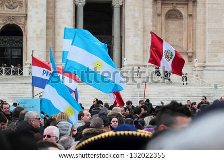ROME, ITALY - MARCH 17: South American flags (Argentina, Peru, Paraguay) in St. Peter Square before the first Angelus prayer of Pope Francis I on March 17, 2013 in Vatican City, Rome, Italy - stock photo