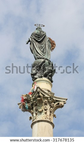 ROME, ITALY - March 11, 2015: The Column of the Immaculate Conception, monument depicting the Blessed Virgin Mary, located in Piazza Mignanelli , Rome, Italy. - stock photo