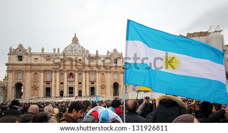 ROME, ITALY - MARCH 17: The crowd is waiting in St. Peter Square before the first Angelus prayer of Pope Francis I, A flag of Argentina in foreground, on March 17, 2013 in Vatican City, Rome, Italy - stock photo