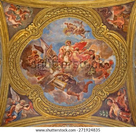 ROME, ITALY - MARCH 25, 2015: The fresco of virtue Charity on the little cupola of side nave in church Basilica dei Santi Ambrogio e Carlo al Corso by Francesco Rosa (1678 - 81). - stock photo