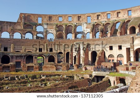 ROME, ITALY - MARCH 07: Tourists inside Colosseum, Rome's most popular tourist attractions on March 07, 2011 in Rome, Italy - stock photo