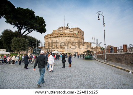 ROME,ITALY-MARCH 15,2014:Tourists stroll among the stalls near Castel Sant'Angelo in Rome on a sunny day - stock photo