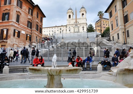 ROME, ITALY - MARCH 14, 2016: Tourists visiting the Spanish square (Piazza di Spagna), one of the major tourist attraction of Rome, Italy - stock photo