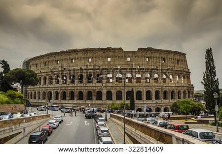 ROME - ITALY, MAY 6 2015: Great Colosseum under a heavy sky. Rome, Italy - stock photo